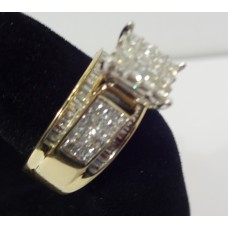 14 Karat Gold Ring w/round diamonds w/baguettes